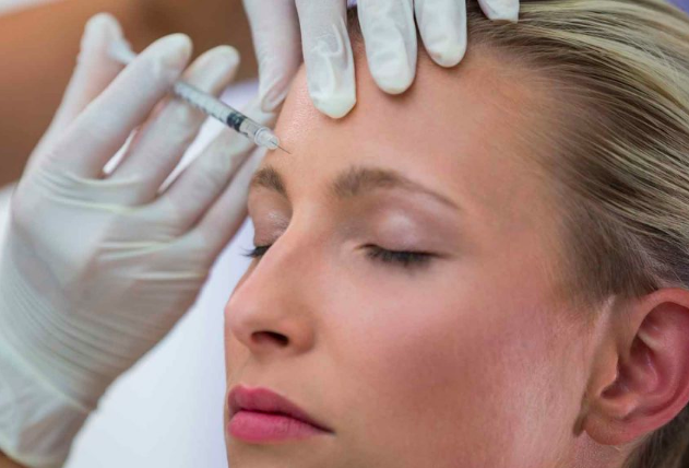 Close up photo of woman's face receiving BOTOX injection.